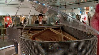 MF at Liberace piano